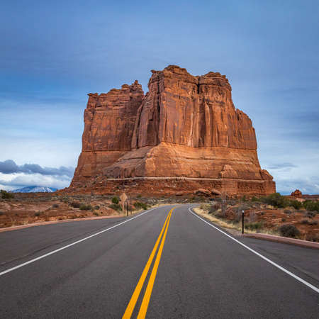 The Organ massive sandstone rock tower seen along Arches Scenic Drive with dramatic storm clouds looming overhead, Arches National Park, Moab, Utah Zdjęcie Seryjne
