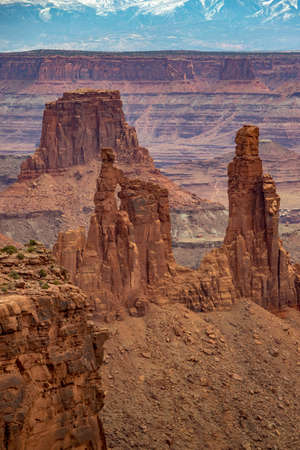 Beautiful view of Buck Canyon, with Washer Woman Arch and Monster Tower in the foreground, Airport Tower in the midground, and La Sal Mountains in the background, Island in the Sky District, Canyonlands National Park, Utah