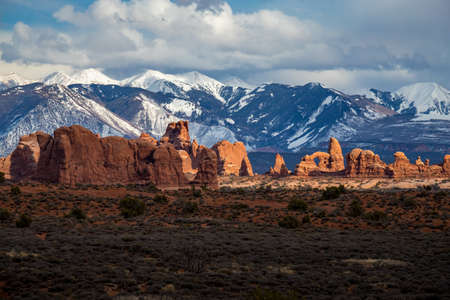 Colorful view of Parade of Elephants sandstone rock formations in the high desert with snowcapped La Sal Mountains in the background, Arches National Park, Moab, Utah