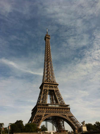 The sight of the dominant steel tower in Paris in summer