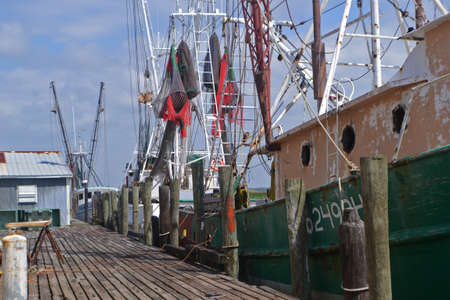 large shrimp boats at wooden dock.jpg