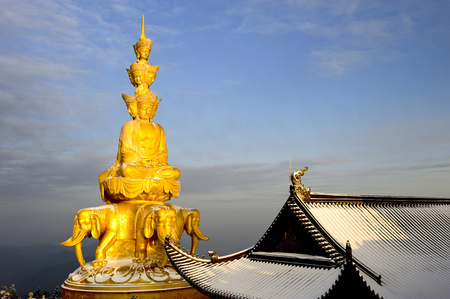 10 key: Golden Buddhism statue at the temple of Emei Mountain
