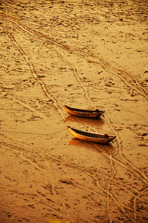 Two fishing boats on the beach photo