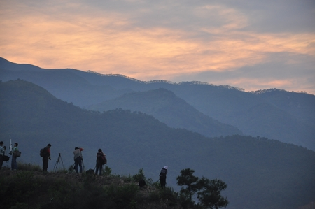 silhouette of ameteur photographers on the mountain