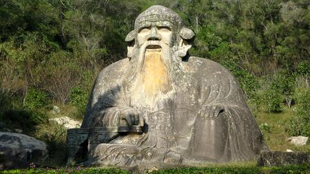 Maitreya stone statue photo