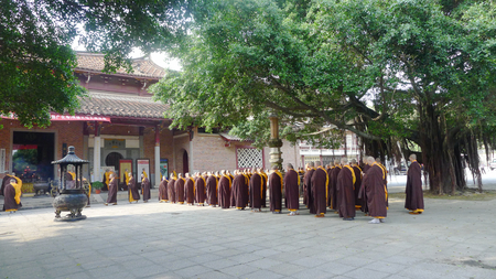 Monks having assembly in front of temple