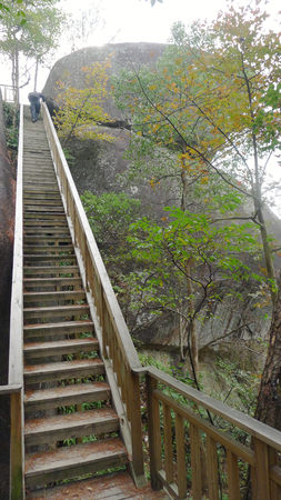 Wooden stairs up the rocky mountain