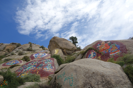 Tibetan cliff carving and rock painting