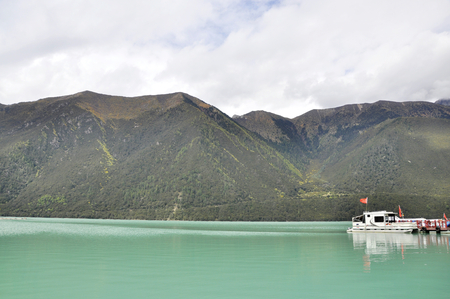 Boat in a lake by the mountains