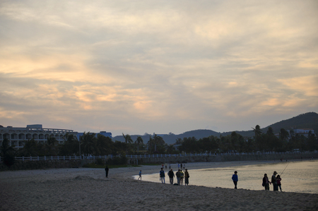 People by the beach in the evening 免版税图像