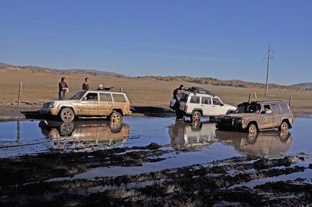 Four wheel drives stuck in muddy floor