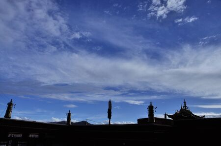 Beautiful clouds in the sky above the temple buildings 免版税图像