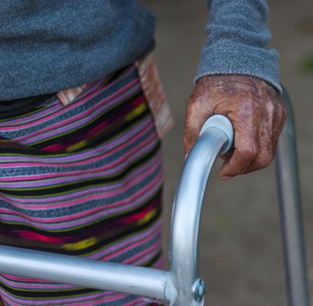 crutch: Closeup old hand with crutch Stock Photo