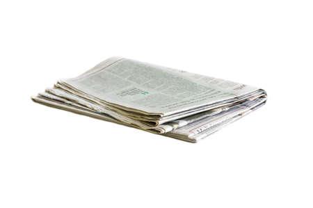 Periódico doblado y apilado fondo blanco y negro borroso Foto de archivo