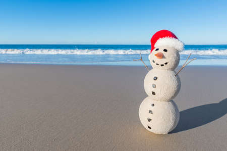 Christmas Sandy Snowman on a beautiful sand beach - Christmas symbol of countries where the weather is always warm Stock Photo