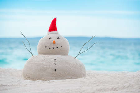 Australian Christmas Sandman on a beautiful white sand beach Stock Photo