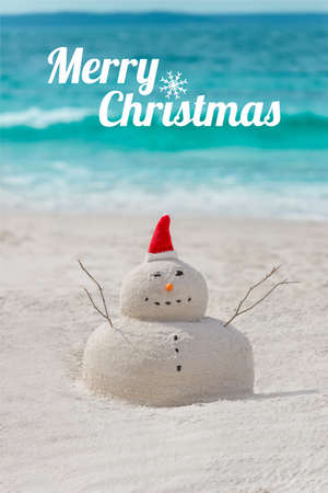 Australian Christmas Sandman with an empty board - place for your text - on a beautiful white sand beach Stock Photo