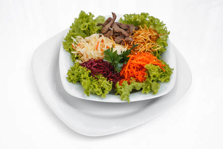 Fresh vegetable salad with slices of meat, filmed on a sheet of white plastic, close-up Stok Fotoğraf