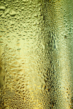 dampen: misted glass of cold drink, close-up