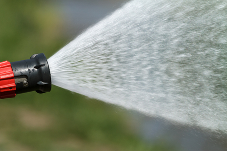 under fire: jet of water under high pressure, beating of a fire hose