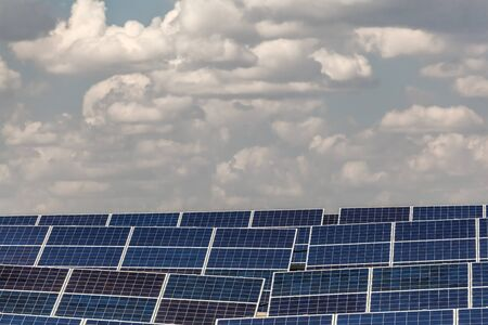power plants: elements of solar power plants against the sky with clouds Stock Photo