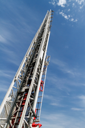 emergency stair: Sliding fire ladder against cloudy, blue sky