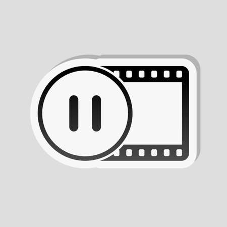 Movie strip with pause symbol in circle. simple silhouette. Sticker style with white border and simple shadow on gray background