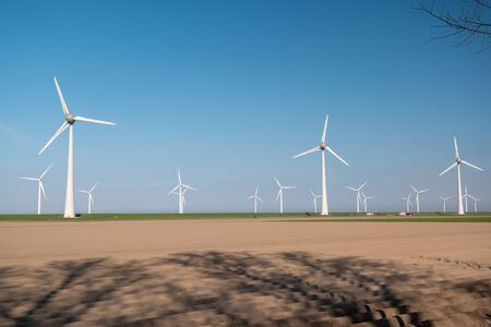 Windmill park green energy in the Netherlands, wind mill turbine generator farm ocean 写真素材 - 146397091