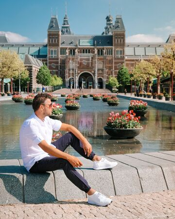 man on city trip during Spring 2020, visit the city of Amsterdam Archivio Fotografico