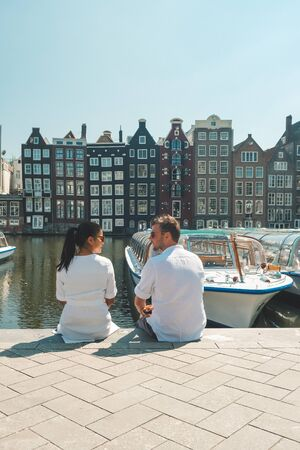 man and woman on city trip during Spring 2020, couple visit the city of Amsterdam