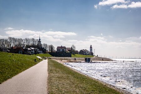 Urk Netherlands, lighthouse of Urk on a bright summer day with no people on the boulevard