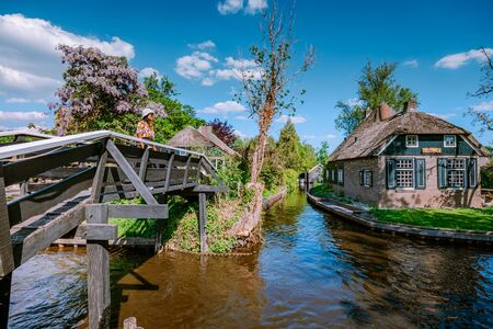 GIETHOORN, NETHERLANDS view of typical houses of Giethoorn on May 2020 in Giethoorn,The Netherlands. The beautiful houses and gardening city is know as Venice of the North