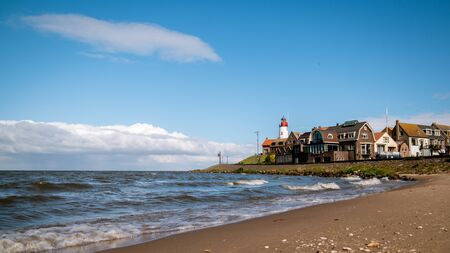 Urk Nehterlands, small fishing village Urk with is colorful lighthouse by the lake Ijsselmeer Netherlands Flevoland