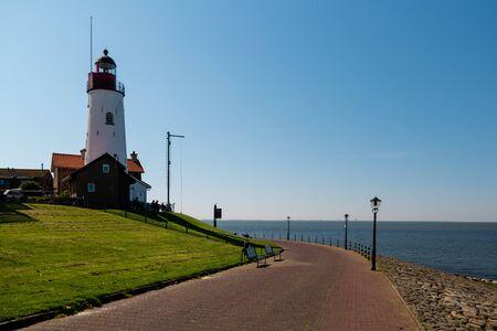 lighthouse Urk Netherlands Spring 2020 on a bright sunny day
