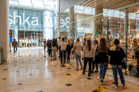 Utrecht Netherlands May 23 2020, shopping mall Hoog Catharijne on a bussy weekend day during the coronavirus outbreak with people waiting in lines on 1,5 meter distance to enter the shop save during the covid 19 outbreak worldwide Editorial