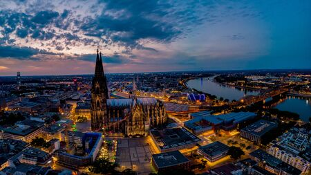 Colgne Koln Cathedral during sunset , drone aerial vie over Cologne and the river rhein during sunset in Germany Europe dusk