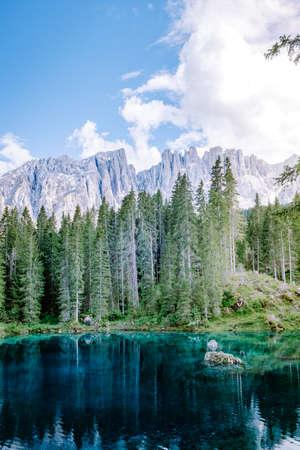 bleu lake in the dolomites Italy, Carezza lake Lago di Carezza, Karersee with Mount Latemar, Bolzano province, South tyrol, Italy. Landscape of Lake Carezza or Karersee and Dolomites in background, Nova Levante, Bolzano, Italy. Europe