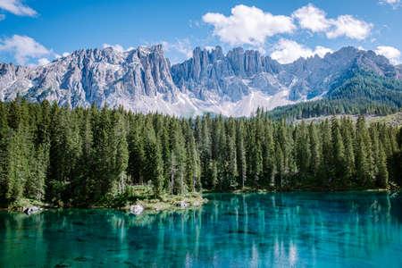 bleu lake in the dolomites Italy, Carezza lake Lago di Carezza, Karersee with Mount Latemar, Bolzano province, South tyrol, Italy. Landscape of Lake Carezza or Karersee and Dolomites in background, Nova Levante, Bolzano, Italy. Europe Reklamní fotografie