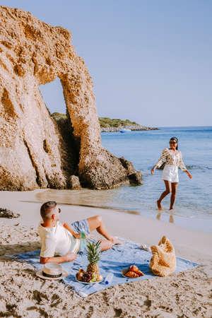 Tropical beach of Voulisma beach, Istron, Crete, Greece ,Most beautiful beaches of Crete island -Istron bay near Agios Nikolaos young couple mid age on vacation 版權商用圖片