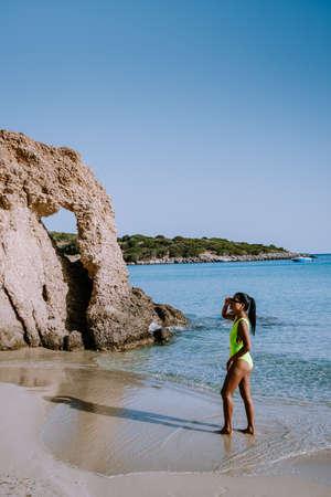 Tropical beach of Voulisma beach, Istron, Crete, Greece ,Most beautiful beaches of Crete island -Istron bay near Agios Nikolaos. young woman on the beach of Crete 版權商用圖片