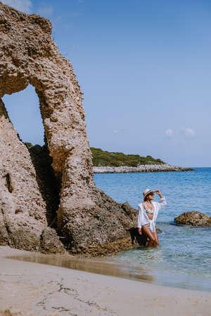 Tropical beach of Voulisma beach, Istron, Crete, Greece ,Most beautiful beaches of Crete island -Istron bay near Agios Nikolaos young asian woman mid age on vacation Greece Crete 版權商用圖片