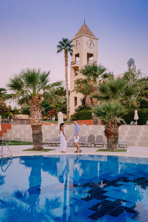 Crete Greece, Candia park village a luxury holiday village in Crete Greece by the ocean in traditional colors. Couple on vacation luxury resort 版權商用圖片