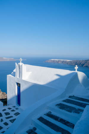 White church at Fira Santorini, Panoramic view of mountains, sea and nature from Fira town, Santorini island Greece. View of the caldera and ships in the bay of Santorini