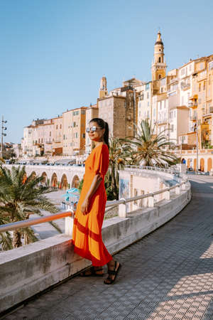 Menton France, woman on vacation at the Cote d Azur France, View on old part of Menton, Provence-Alpes-Cote dAzur, France Europe Stock Photo