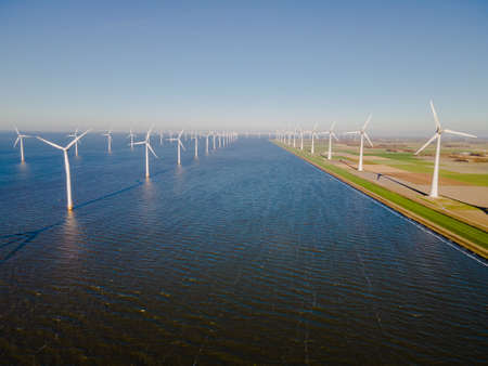 Windmill park in the Netherlands ocean, Windmill farm with huge turbines green energy in the Netherlands Europe. High wind turbines 写真素材 - 159639057