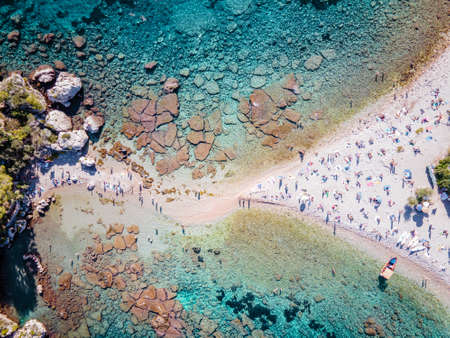 Isola Bella at Taormina, Sicily, Aerial view of the island and Isola Bella beach and blue ocean water in Taormina, Sicily, Italy Europe 写真素材
