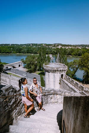 couple city trip Avignon Southern France, Ancient Popes Palace, Saint-Benezet, Avignon, Provence, France Europe Stock Photo