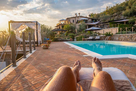 Luxury country house with swimming pool in Italy. Pool and old farm house during sunset central Italy Foto de archivo