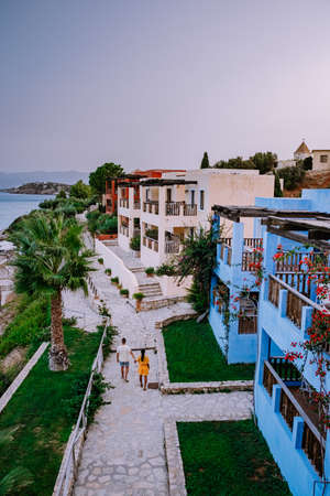 Crete Greece, Candia park village a luxury holiday village in Crete Greece by the ocean in traditional colors, couple on vacation in Greece
