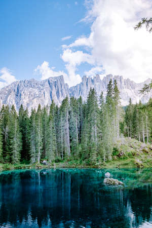 bleu lake in the dolomites Italy, Carezza lake Lago di Carezza, Karersee with Mount Latemar, province, South tyrol, Italy. Landscape of Lake Carezza or Karersee and Dolomites in background, Nova Levante, , Italy. Europe
